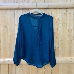 Turquoise silk blouse with neck line tie.